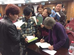 Signing books for parents after lecture, Jiaxing, Zhejiang province